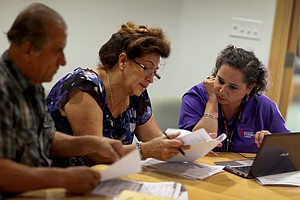 A Rush To Reconcile Health Enrollment Data, By Hand