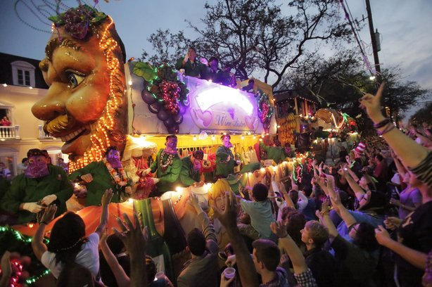 Sunday: A float rolling through during the Krewe of Bacchus parade.