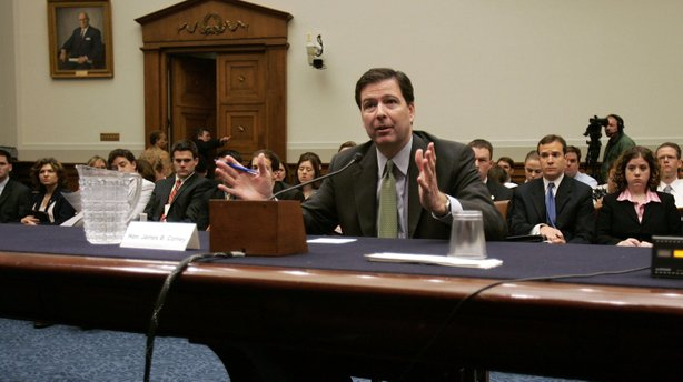 Jim Comey, then deputy attorney general, testifies during a House Judiciary Committee hearing in 2005.