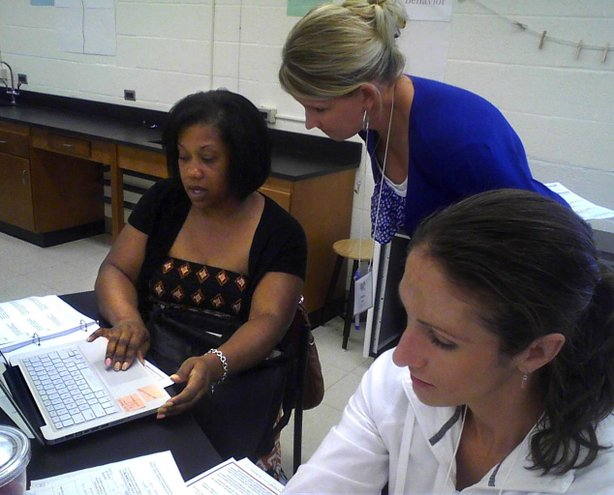 Teacher Karen Pate assists math teachers with Common Core materials in Baltimore. As in other states, Maryland teachers are attending trainings to prepare to implement the new standards this fall.