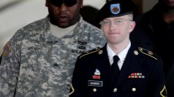 Army Pfc. Bradley Manning (right) is escorted out of a courthouse in Fort Meade, Md., on June 25, 2012. His attorney announced that Manning, who is accused of leaking classified information to WikiLeaks, had agreed to plead guilty to lesser charges.