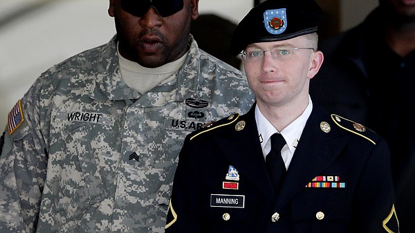 Army Pfc. Bradley Manning (right) is escorted out of a courthouse in Fort Mea...