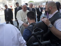 Pope Francis blesses a sick or disabled person wearing Harley-Davidson garb at the end of a pro-life Mass in St. Peter's Square, at the Vatican on Sunday.