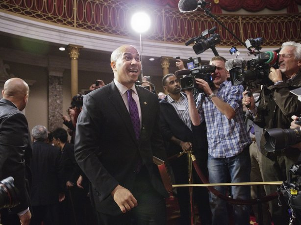 Democratic Sen. Cory Booker, formerly mayor of Newark, N.J., arrives in the Old Senate Chamber on Thursday for an oath-of-office ceremony.