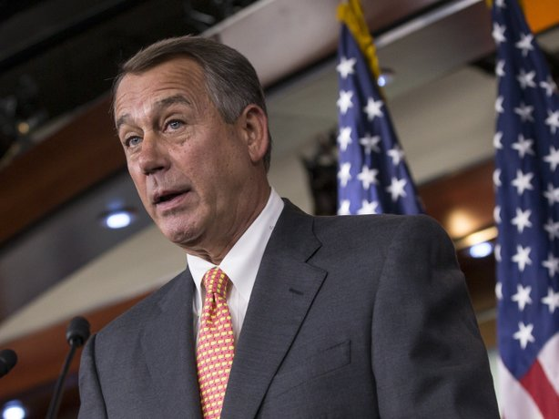Speaker of the House John Boehner (R-Ohio) talks to reporters Thursday about the deadline to fund the government while simultaneously eliminating President Obama's health care law.