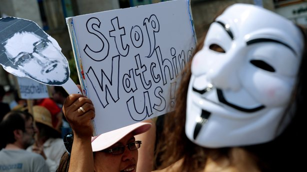 Protesters demonstrate against alleged NSA surveillance in Germany during a rally in Hannover, Germany on Saturday.