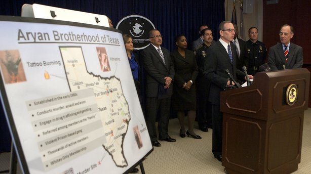 Assistant Attorney General Lanny Breuer speaks at the U.S. attorney's office in Houston on Nov. 9, 2012. Officials announced the arrest of dozens of Texas members of the white supremacist Aryan Brotherhood gang on federal racketeering charges for crimes including murder, kidnapping, arson, gambling and trafficking in methamphetamine and cocaine.