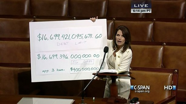 Rep. Michele Bachmann (R-Minn.) holding a floor chart without the help of an easel.