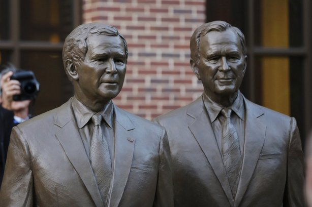 Statues of former Presidents George W. Bush (left) and George H.W. Bush greet visitors to the George W. Bush Presidential Center in Dallas.
