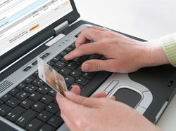 A man types credit card information into a laptop computer in this undated photo.