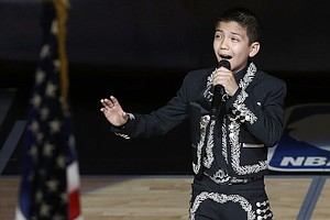 11-Year-Old Keeps Singing In Face Of Hate