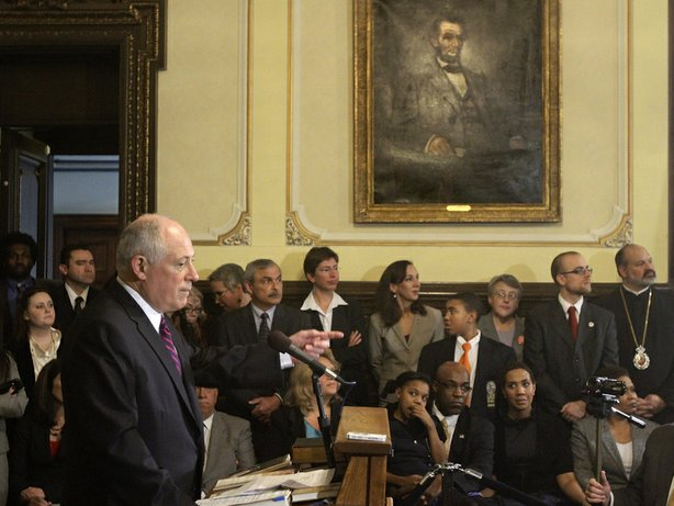 Illinois Gov. Pat Quinn speaks with reporters in 2011 after signing legislation abolishing the death penalty in the state at the capitol in Springfield.