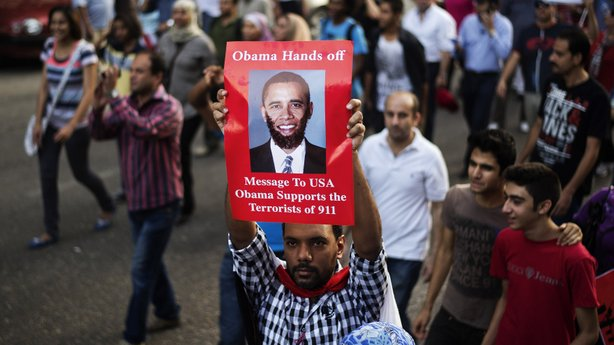A protester denounces President Obama during a march near Cairo's Tahrir Square on July 7. Bitter rivals in Egypt tend to be united in opposition to the U.S. government, which has been a leading aid donor to the country for decades.