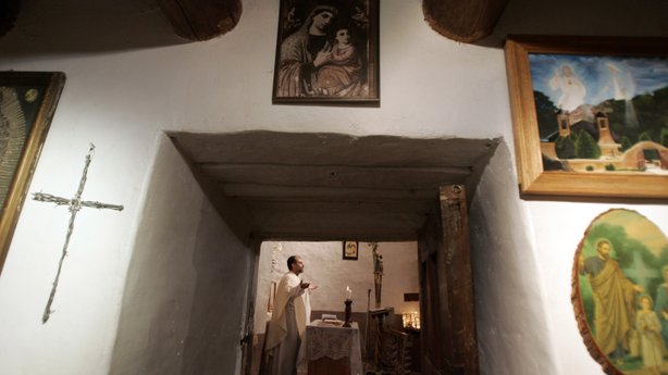 Father Julio Gonzalez led the Easter Mass at El Santuario de Chimayo on April 8, 2007. Thousands of visitors make a pilgrimage to visit the small chapel annually every Easter weekend. Many people believe that the dirt inside the chapel has healing powers.