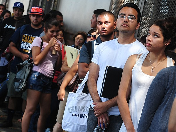 Young people stand in line in Los Angeles to apply for th...