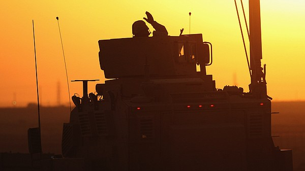 A soldier in the last American military convoy to depart Iraq, from the 3rd B...