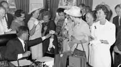 President Kennedy passes out pens on June 10, 1963, after signing the Equal P...