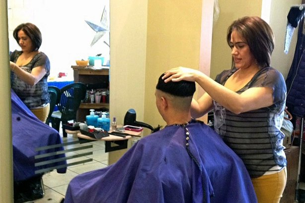 Health workers know places like Karina Cardoso's beauty salon in St. Paul, Minn., are prime places share information about the state's new health insurance options.