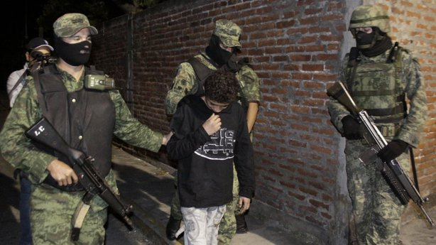 "A 2010 file photo shows Edgar ""El Ponchis"" Jimenez Lugo in the city of Cuernavaca, Mexico. The teenage U.S. citizen who acknowledged being a drug-cartel killer has finished his three year juvenile-offender term for homicide, kidnapping and drug and weapons possession."