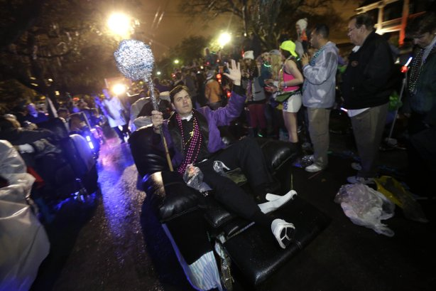 Monday: Members of the Laissez Boys Pleasure Aid & Leisure Club parade during the Krewe of Orpheus parade.