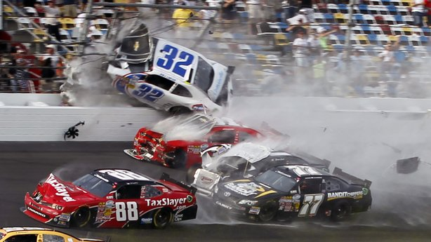 Kyle Larson (32) goes into the catch fence at the conclusion of the NASCAR Nationwide Series auto race Saturday at Daytona International Speedway in Daytona Beach, Fla.