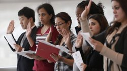 Immigrants take the U.S. oath of citizenship during a naturalization ceremony...
