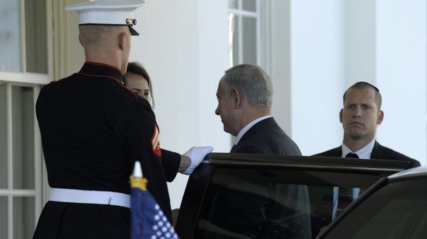 Israeli Prime Minister Benjamin Netanyahu arrives at the White House in Washington Monday to meet with President Obama. The two are expected to discuss Iran's nuclear program, Syria's civil war, and peace negotiations with the Palestinians.