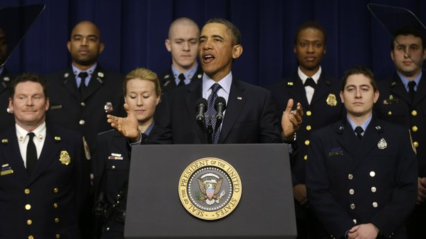 President Obama, accompanied by emergency responders, a group of workers the White House says could be affected if state and local governments lose federal money as a result of budget cuts, speaks in the Eisenhower Executive Office building in Washington on Tuesday.