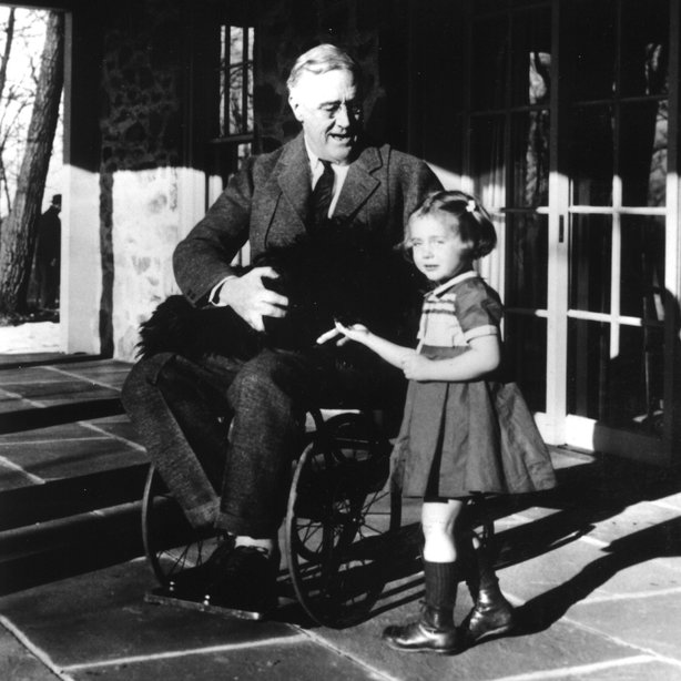 Photos of President Franklin D. Roosevelt sitting in a wheelchair are also rare and weren't shown to the public while he was in office. In this image from 1941 he's with his dog Fala and Ruthie Bie, the granddaughter of a gardener who worked for the Roosevelt family.