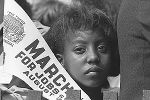 At 1963 March, A Face In The Crowd Became A Poster Child