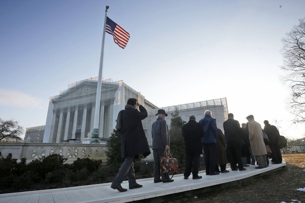 People file into the Supreme Court on Tuesday for the court's hearing on Cali...