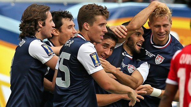 Members of the U.S. national team, including Michael Parkhurst (#15) and Landon Donovan (#10) celebrate with Brek Shea, right after Shea scored the game-winning goal against Panama in Sunday's CONCACAF Gold Cup final.