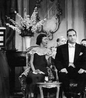 Caesar, flanked by cast performers Imogene Coca and Carl Reiner, listens to a singer in a skit from the TV comedy series