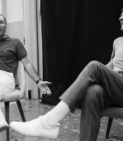 Comedian and writer Mel Brooks (left) sits with Caesar