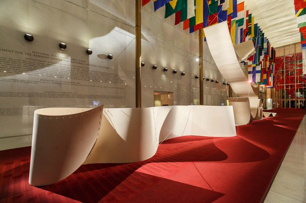 The Hall of Nations is transformed by a plywood installation called
