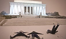 People make snow angels in the snow in front of the Lincoln Memorial as a heavy snow storm hits Washington, D.C. As expected, a dangerous winter storm has now spread snow, sleet, ice, freezing rain or some combination of all four from Texas to the mid-Atlantic.
