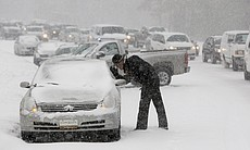 A Highway Patrol officer checks on the safety o...