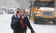 Katharine Newton, a student at the University of North Carolina at Chapel Hill, calls her parents while walking more than two miles from campus to her home on Wednesday as the winter storm rolled through. Roads were blocked.