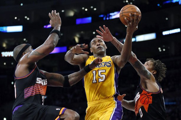 The Los Angeles Lakers' Metta World Peace (center), formerly known as Ron Artest, has been suspended 12 times for displays of violence during his career. Here, he is fouled during a recent game against the Phoenix Suns.