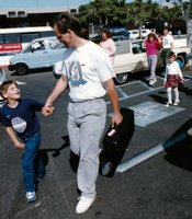 Isidor with his adoptive father on first arriving in San Diego from Romania.