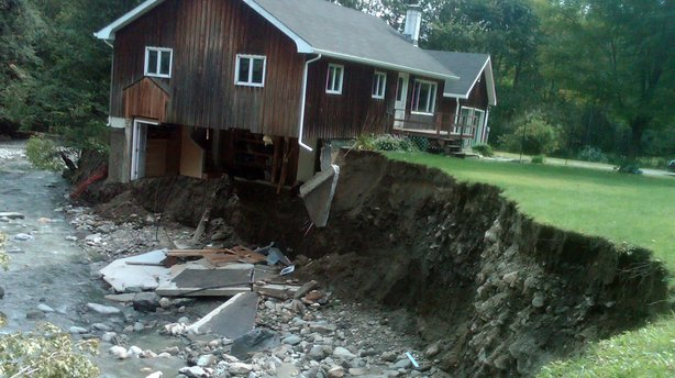 A house sits destroyed by Tropical Storm Irene in Rochester, Vt., on Aug. 31, 2011.