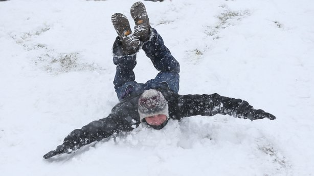 In St. Louis on Sunday the sliding — even without a sled — was good. The area got 6 to 12 inches of new snow over the weekend.