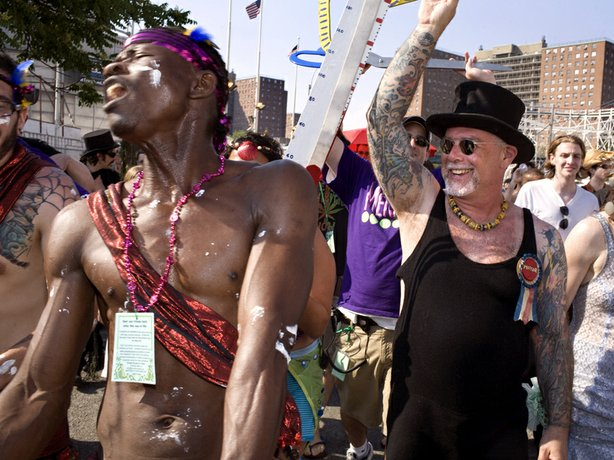 Dick Zigun (right) with a Mermaid Parade reveler. Zigun founded Coney Island's Mermaid Parade in 1983.